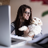 woman and her dog at computer